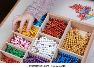 Work with Montessori material, study of the multiplication table