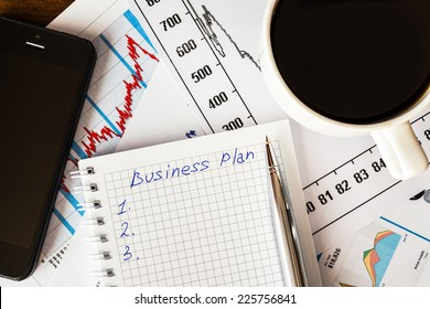 Work in the office, coffee cup with business plan