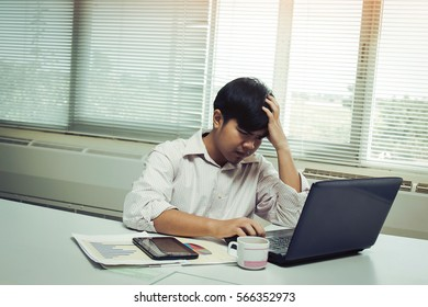 Work office man with stressed feeling in dark tone