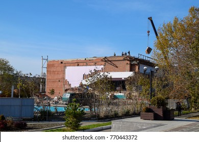 Work on the building repair, demolition of old elements. Descent lifting operation using a crane.