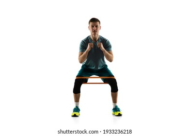 Work out. Young caucasian male model in action, motion isolated on white background with copyspace. Concept of sport, movement, energy and dynamic, healthy lifestyle. Training, practicing. Authentic.