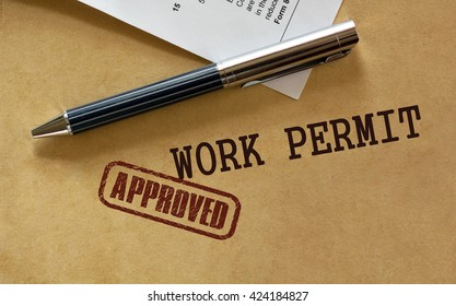 Work permit approved stamp.