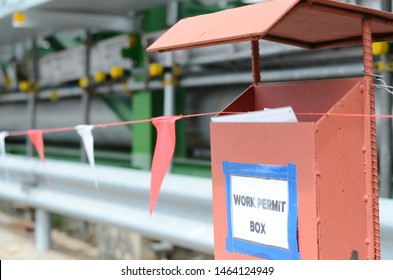 Work permit box is located on the construction work area.