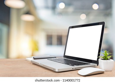 Work place concept Mockup blank screen laptop on desk. Workspace with laptop and office supplies