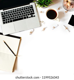 Work place in flat lay style. Cute modern white office desk table with laptop, smartphone, office plant, fortune notes, notebook, pen and pencil. Top view with copy space, flat lay, square crop