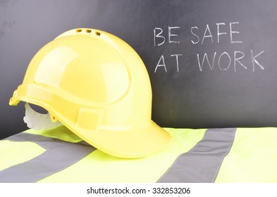 Work Place Safety Concept with safety equipment and a blackboard in the background