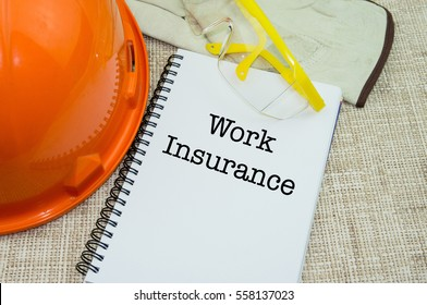 Work Place Safety and Health at Workplace Concept with WORK INSURANCE wording on notebook