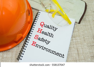 Work Place Safety and Health at Workplace Concept with QHSE wording on notebook