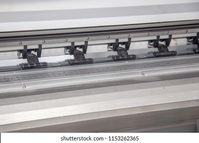 Work in the printing house. The printer works on a plotter. solvent, print machine