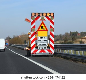 Work in progess in the highway the text meas Reduce speed because there are Men at Work in Italian langauge