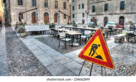 work in progress sign in a small italian square
