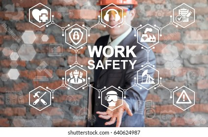 Work Safety Concept - regulations and standard in industry, business. First secure rules. Health protection, personal security people on job. Man in helmet offers work safety icon on virtual screen.