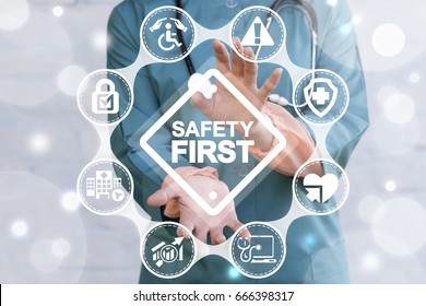 Work Safety Concept - regulations and standard in medical hospital. Doctor offers safety first sign on virtual screen. First secure rules.