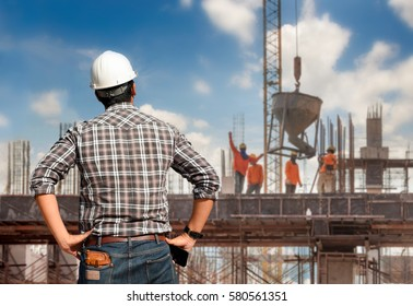 Work Safety officer or Civil Engineer. team worker on background