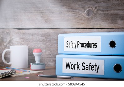 Work Safety and Safety Procedures. Two binders on desk in the office. Business background