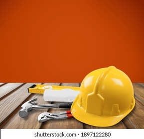 Work safety protection equipment. Industrial protective helmet on wooden table