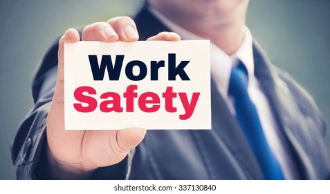 Work Safety word on the card held by a man hand, vintage tone