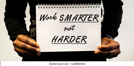 Work Smarter Not Harder Concept in Black African American woman's hands for motivational and work efficiency concept