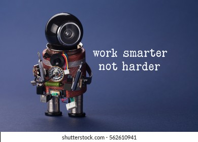 Work smarter not harder concept. Abstract electronic worker with screwdrivers in arms. closeup, shallow depth of field, blue background.