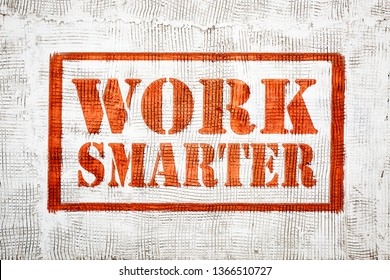 work smarter - red graffiti style sign on a white stucco wall
