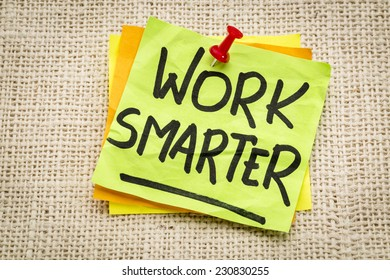 work smarter reminder on a green sticky note against burlap canvas