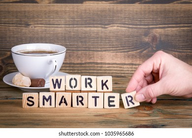 work smarter. Wooden letters on the office desk, informative and communication background