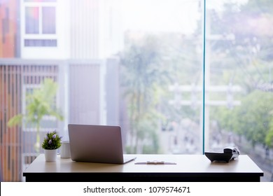 Work space with laptop and office accessory on table. - Shutterstock ID 1079574671