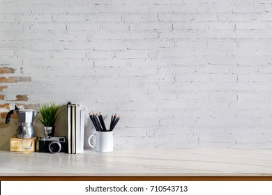 Work space Mock up white marble tabletop with books, pencils and houseplant. Marble desk with copy space for products display montage.