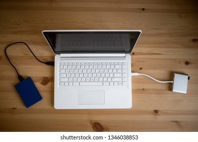 Work space on table of photographer. Minimal workspace with Laptop, camera and lens copy space on wooden background. Modern and elegant. Top view. Flat lay style. Close up