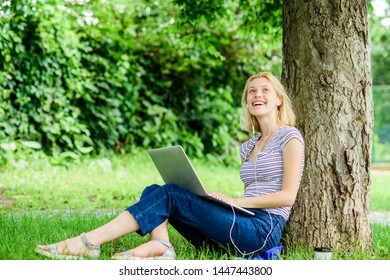 Work in summer park. Girl work with laptop in park. Reasons why you should take your work outside. Nature is essential to wellbeing and ability to be productive and high functioning at work.