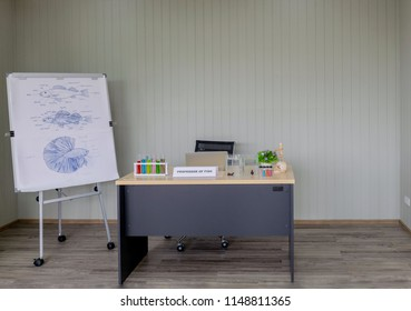 Work table of professor of fish with the stand of  anatomy fish drawing on the white paper in front of the laboratory lecture room