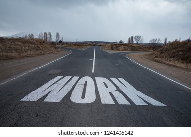Work text on road under sky