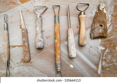 Work tools in a messy ceramics workshop, overhead view