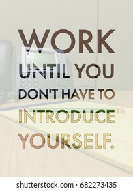 Work Until You Don't Have To Introduce Yourself typography design on image of office cubicle.