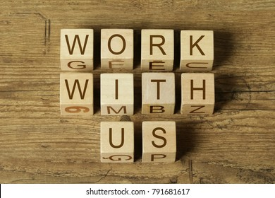 WORK WITH US text on wooden cubes