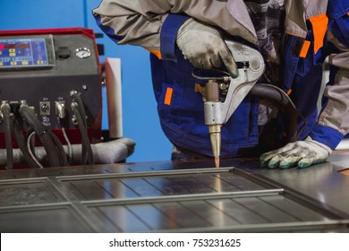 Work using mechanized hand for spot welding of metal izdeliy.Muzhchina working in a factory with a metal, its duty spot welding and soldering.