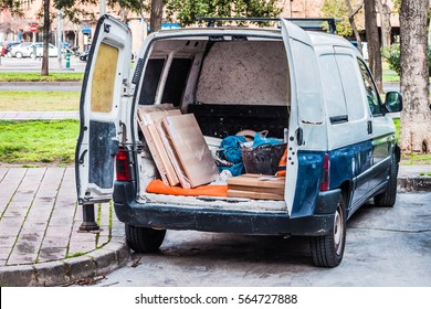 Work van with the door open in the back with working tools inside