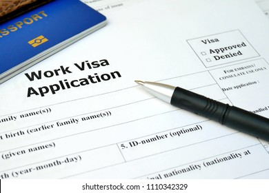 Work Visa application form with passport and pen. Document with passport, apply and permission for foreigner country