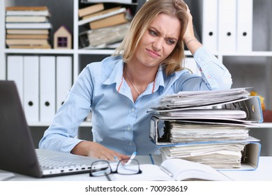 Lot of work wait for tired and exhausted woman. Huge pile of document folders, headache and depression, irs, new problems, emotion expression, vacancy or holiday dream concept