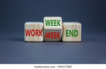 Work week or weekend symbol. Turned the wooden cube and changed words 'Work week' to 'Weekend'. Beautiful grey background. Work week or weekend and business concept. Copy space.