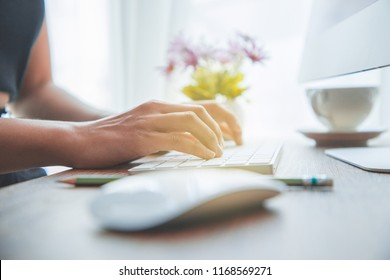 Work. Woman Hands Typing On Keyboard At Workplace. Closeup Of Female Worker Working On Computer Sitting At Table With Cup Of Coffee And Office Tools On.