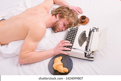 Workaholic fall asleep. Man with typewriter sleep. Exhausting occupation. Man sleepy lay bedclothes while work. Writer used old fashioned typewriter. Author tousled hair fall asleep while write book.