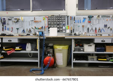 Workbench with many tools inside a mechanic workshop specialized in repairing bicycles