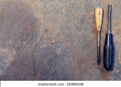 Workbench metal table with old tools. Top view with copy space. Toned