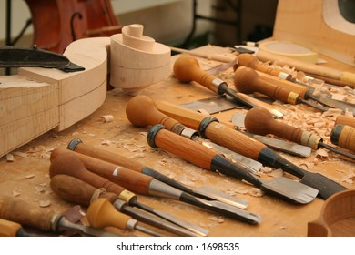 Workbench with tools for making wooden musical instruments