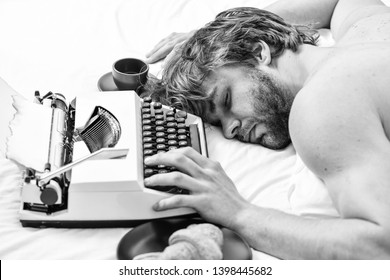 Worked all night. Man fall asleep. Writer used old fashioned typewriter. Author tousled hair fall asleep while write book. Workaholic fall asleep. Man with typewriter sleep. Deadline concept.