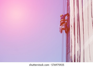 worker abseiling for seal joint the precast