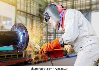 worker arc welder steel piping welding in factor