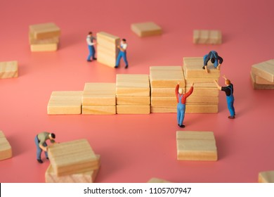 Worker arranging wood step stair. Business concept of process