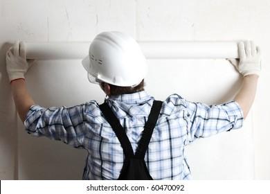 worker attaching wallpaper
